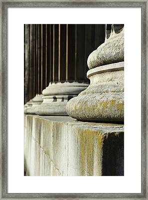 Stone Pillars Concept Of Justice And Strength Framed Print by Matthew Gibson