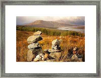 Stone Stacks In The Highlands Framed Print by Jane Rix
