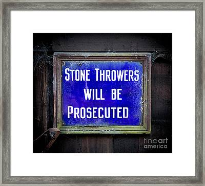 Stone Throwers Be Warned Framed Print by Adrian Evans