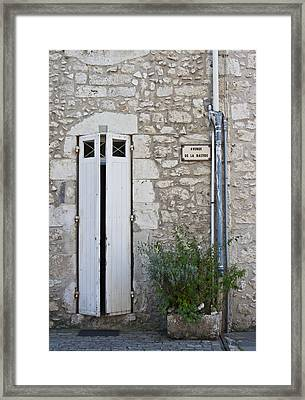 Stone Wall Shutters And Plant Framed Print by Georgia Fowler