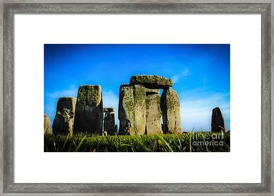 Stonehenge From The Earth Framed Print by David Warrington