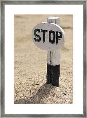 Stop Sign On Sand Framed Print by Sami Sarkis
