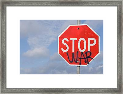 Framed Print featuring the photograph Stop War Sign by Charles Beeler