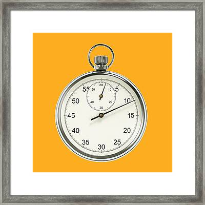 Stopwatch On Yellow Background Framed Print