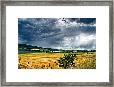 Storm And Sunbeams Framed Print