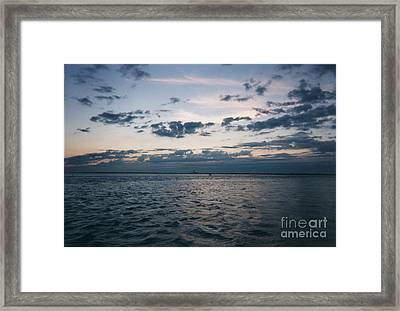Storm Approaching Over Sunset Framed Print by John Telfer
