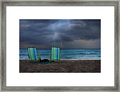 Storm Chairs Framed Print