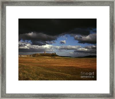 Storm Clouds And Dunstanburgh Castle  At Embleton Bay Embleton Northumberland England Framed Print by Michael Walters