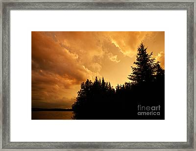 Storm Clouds At Sunset Framed Print by Larry Ricker