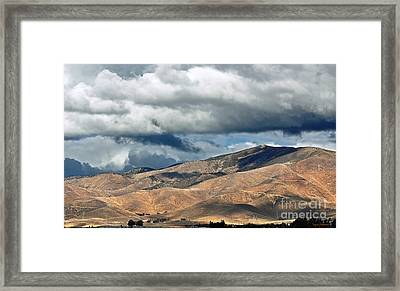 Storm Clouds Floating Above Mountains Framed Print