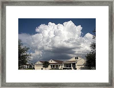 Storm Clouds Over Clermont Framed Print by Carl Purcell