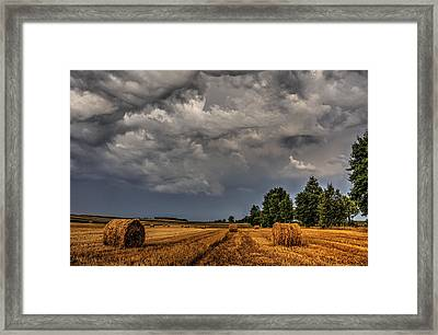 Storm Clouds Over Harvested Field In Poland 2 Framed Print
