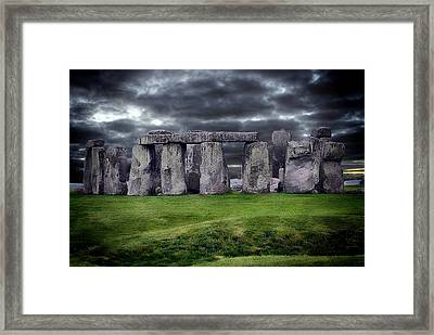 Storm Clouds Over Stonehenge Framed Print by Anthony Dezenzio