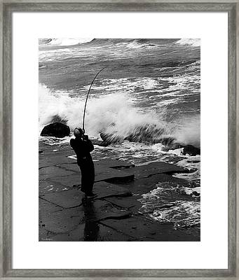 Storm Fishing Framed Print by Travis Burgess