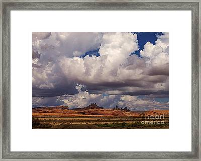 Storm Over Monument Valley Framed Print by Janice Rae Pariza