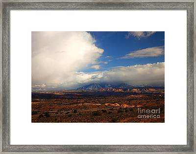 Storm Over The La Sals Framed Print by Mike  Dawson