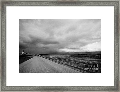 storm snow clouds forming over country road on the prairies assiniboia Saskatchewan Canada Framed Print