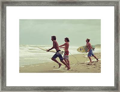 Storm Surfers Framed Print by Laura Fasulo