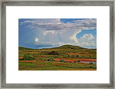 Storm's Brewing Framed Print