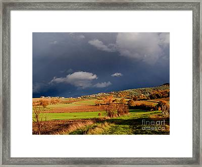 Stormy Countryside Framed Print by Tim Holt