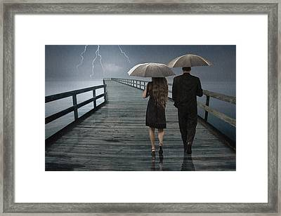 Stormy Relationship Framed Print by Randall Nyhof