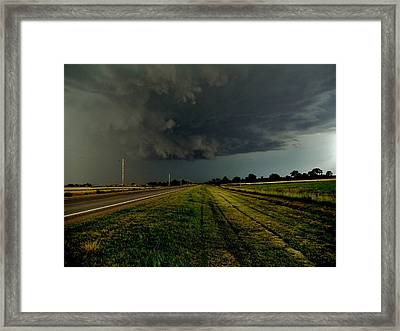 Stormy Road Ahead Framed Print by Ed Sweeney