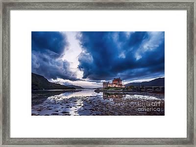 Stormy Skies Over Eilean Donan Castle Framed Print