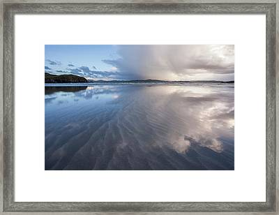 Stormy Skies Reflecting In The Sand Framed Print by Peter McCabe
