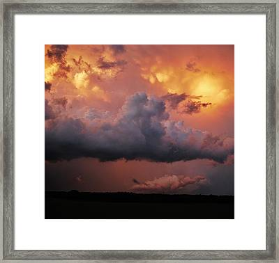 Stormy Sunset Framed Print by Ed Sweeney