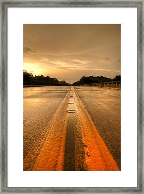 Stormy Yellow Lines Framed Print by David Paul Murray