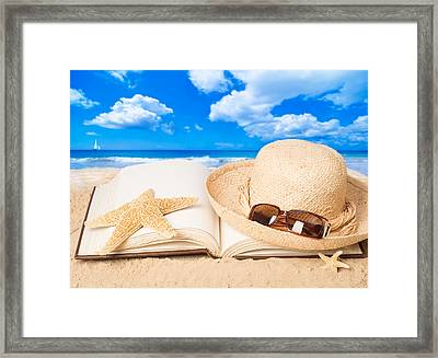 Straw Hat On Beach Framed Print