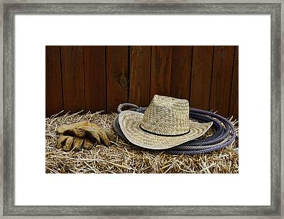 Straw Hat  On  Hay Framed Print by Paul Ward