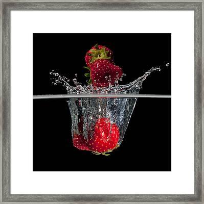 Strawberries Splashing In Water Framed Print
