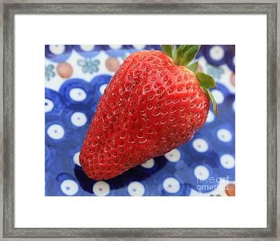 Strawberry On Blue Plate Framed Print by Carol Groenen