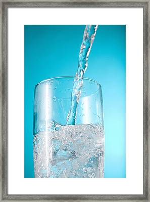 Stream Of Water Being Poured Into A Framed Print by Greg Huszar Photography