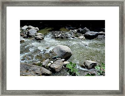 Framed Print featuring the photograph Stream Water Foams And Rushes Past Boulders by Imran Ahmed