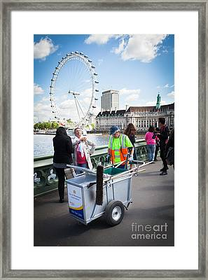 Street Cleaner With Cart Amongst Tourists With London Eye. Framed Print by Peter Noyce