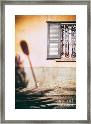 Framed Print featuring the photograph Street Lamp Shadow And Window by Silvia Ganora
