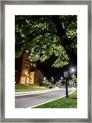 Street Lights In Slow Ville Framed Print by Rhys Arithson