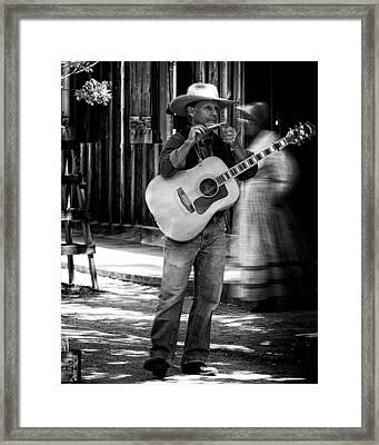 Street Musician Framed Print by Thomas Hall