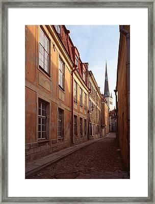 Street Scene In Old Town Talliin Framed Print by Cliff Wassmann