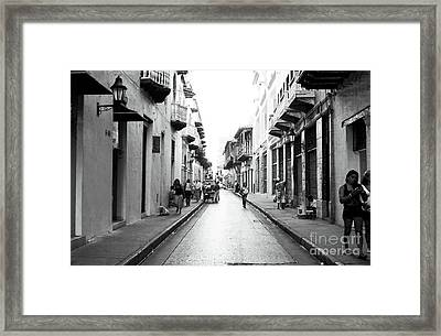 Streets Of Cartagena I Framed Print by John Rizzuto