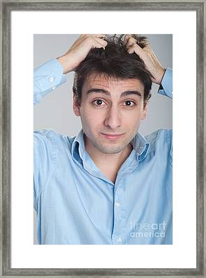 Stressed Business Man Framed Print by Luis Alvarenga
