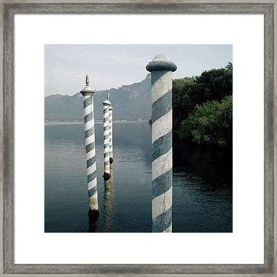 Striped Posts In The Grand Canal Framed Print by Leombruno-Bodi