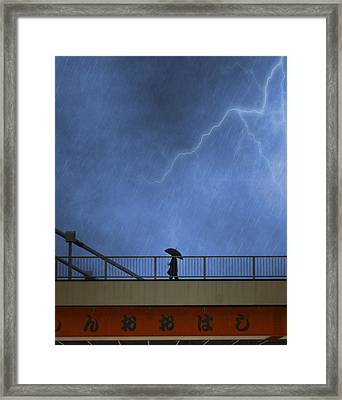 Strolling In The Rain Framed Print
