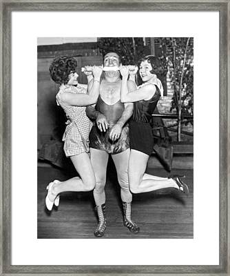 Strongman Lifts With His Teeth Framed Print by Underwood Archives