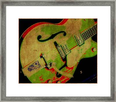 Strum Framed Print