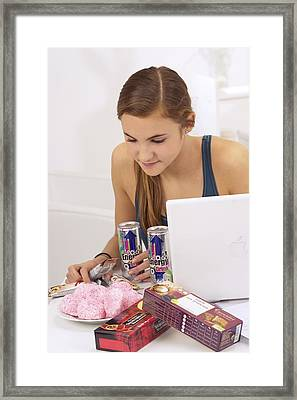 Student Eating Sugary Snacks Framed Print by Science Photo Library