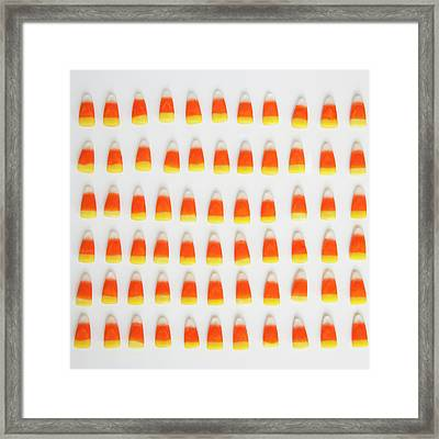 Studio Shot Of Rows Of Candy Corn Framed Print by Jessica Peterson