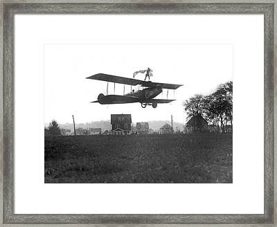 Stunts Atop A Biplane Framed Print by Underwood Archives